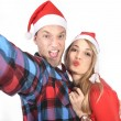 Young romantic couple in love taking selfie mobile phone photo at Christmas — Stock Photo #58583641