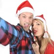 Young romantic couple in love taking selfie mobile phone photo at Christmas — Stock Photo #58583857