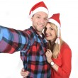 Young romantic couple in love taking selfie mobile phone photo at Christmas — Stock Photo #58583995