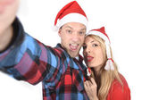 Young romantic couple in love taking selfie mobile phone photo at Christmas — Stock Photo