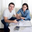 Young husband cutting credit card with scissors woman trying to stop him — Stock Photo #59626551