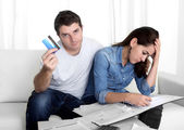 Young couple worried at home in stress accounting bank payments  — Stock Photo