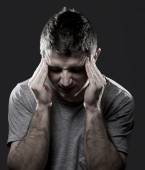 Man suffering migraine headache in pain feeling sick with hands on tempo — Stock Photo