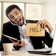 Businessman in stress holding help sign multitasking overwhelmed in business district office — Stock Photo #62114591