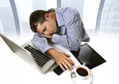 Overworked businessman asleep at work tired and overloaded sitting with computer — Stock Photo