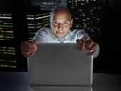 Addict man at office computer laptop watching porn internet addiction concept — Stock Photo