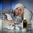 Sick man lying in bed with headache suffering cold and winter flu virus  — Stok fotoğraf #62477863