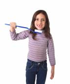 Sweet cute young girl gap toothed with huge toothbrush cleaning her mouth in dental care concept — Stock Photo