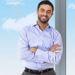 Young attractive business man standing in corporate portrait — Stock Photo #62830751