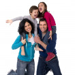 happy Brazilian family mother and father playing with little son and daughter having fun — Stock Photo #63462961