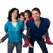happy Brazilian family mother and father playing with little son and daughter having fun — Stock Photo #63465733