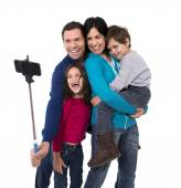 Happy Brazilian family mother and father taking selfie photo with little son and daughter having fun — Stock Photo