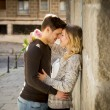 Beautiful couple in love kissing on street alley celebrating Valentines day — Stock Photo #63780435