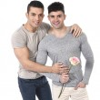 Gay couple of homosexual young strong men in love on valentines with rose — Stock Photo #64479305