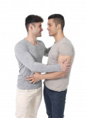 Gay homosexual couple young attractive handsome men in love kissing — Stock Photo