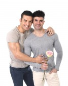 Gay couple of homosexual young strong men in love on valentines with rose — Stock Photo