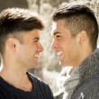 Young happy gay men couple on street free homosexual love concept — Stock Photo #64620841