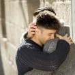 Young happy gay men couple hugging on street free homosexual love concept — Stock Photo #64623365