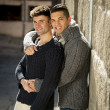 Young happy gay men couple on street free homosexual love concept — Stock Photo #64623677