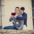 Young  gay men couple with rose and box present celebrating valentines day in love — Stock Photo #64649879