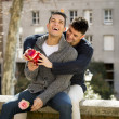 Young  gay men couple with rose and box present celebrating valentines day in love — Stock Photo #64650125