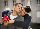 Young  gay men couple with rose and box present celebrating valentines day in love — Stock Photo
