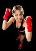 Young attractive girl training boxing fist wrapped fighting woman concept — Stock Photo