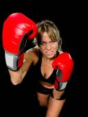 Young fit and strong attractive boxer girl with red boxing gloves fighting throwing aggressive punch training workout in gym feeling angry — Stock Photo