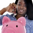Black African American business woman putting coin into huge pink piggybank — Stock Photo #65699281
