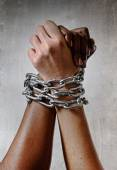 White race hand chain locked together with black ethnicity woman multiracial understanding — Foto de Stock