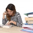 Young student girl concentrated studying for exam at college library education concept — Stock Photo #65720935