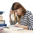 Young student girl concentrated studying for exam at college library education concept — Stock Photo #65721245