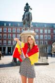 Young happy attractive exchange student girl having fun in town visiting Madrid city showing Spain flag — Stock Photo