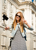 Young beautiful tourist girl visiting Europe in holidays exchange students and taking selfie picture — Stock Photo