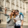 Friends tourist couple visiting Madrid in holidays visiting town happy with city map — Stock Photo #65807707