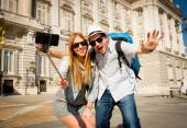 Beautiful friends tourist couple visiting Spain in holidays students exchange taking selfie picture — Stock Photo