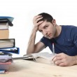 Young stressed student studying on library for exam in stress fe — Zdjęcie stockowe #65874943