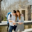 American student and tourist couple reading city map in tourism concept — Stock Photo #66081551