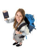 Happy young student tourist woman carrying backpack showing passport in tourism concept — Stock Photo
