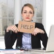 Young stressed businesswoman holding help sign overworked at office computer — Stock Photo #66953701