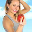 Sexy beautiful woman holding green apple fruit in healthy eatin — Stock Photo #67643553