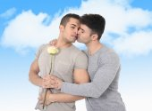 Gay couple of homosexual young strong men in love on valentines outdoors — Stock Photo