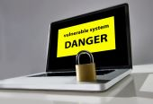 Lock on computer laptop keayboard with warning message danger vulnerable system in hacker attack concept  — Stock Photo