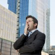 Exhausted tired businessman yawning in need of sleep after long hours of work — Stock Photo #78431596