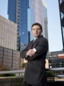 Corporate portrait attractive businessman outdoors urban office buildings — Stock Photo