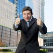 Young successful businessman happy and excited giving thumbs up okay sign — Stock Photo #78474558
