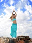 Attractive woman in zen yoga pose at rock mountain top in relax — Stock Photo
