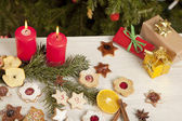 Table with gifts and christmas candles — Stockfoto