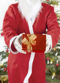 Santa Claus with red gift — Stock Photo