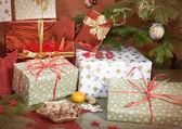 Christmas gifts beside christmas tree — Stock Photo